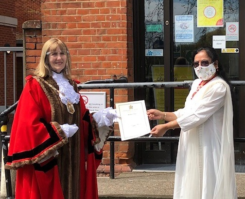 Mayor presents Recognition Award to Sabitri